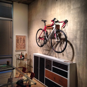My road bike sitting comfortably above our murphy bed. Mounting into any surface is possible and very easy, even this concrete!